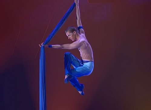 Romain Cabon circus performer from France. Aerial silks acrobat